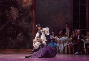 Joanna Wozniak, Lucas Segovia, and the Joffrey Ballet in Christopher Wheeldon's SWAN LAKE - Photo by Cheryl Mann.