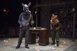 Benjamin (Will Allan) questions the new leadership supported by Squealer (Amelia Hefferon) in Steppenwolf Theatre Company's production of Animal Farm, a world premiere adaptation by Althos Low, directed by Hallie Gordon.