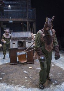 Pinkeye (Lance Newton) and Julia (Jasmine Bracey) pitch in to help Boxer (Matt Kahler) pull the cart in Steppenwolf Theatre Company's production of ANIMAL FARM, a world premiere adaptation by Althos Low, directed by Hallie Gordon.