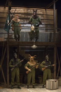 (left to right, top to bottom) Squealer (Amelia Hefferon), Napoleon (Blake Montgomery), Dog (Sean Parris), Muriel (Mildred Marie Langford) and Dog (Dana Murphy) enforce a new order in Steppenwolf Theatre Company's production of ANIMAL FARM, a world premiere adaptation by Althos Low, directed by Hallie Gordon.