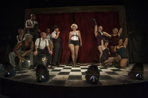 Danni Smith (center) with the company of Bailiwick Chicago's production of THE WILD PARTY. Photo by Michael Brosilow.
