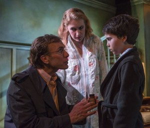 Darrell W. Cox, Abigail Boucher, and Aaron Lamm in David Mamet's THE CRYPTOGRAM at Profiles Theatre. Photo by Michael Brosilow.