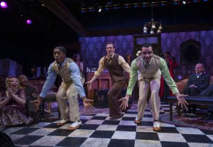 (center, left to right) Gilbert Domally, Matthew Keffer and Desmond Gray with the company of Bailiwick Chicago's production of THE WILD PARTY. Photo by Michael Brosilow.