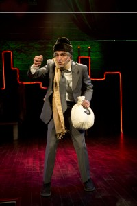 Ebenezer Scrooge (GQ) travels through the hip-hop ages—decade by decade from past to present to future—in Chicago Shakespeare Theater's production of A Q Brothers' Christmas Carol in the theater Upstairs at Chicago Shakespeare, now through December 31. Photo by Michael Brosilow.