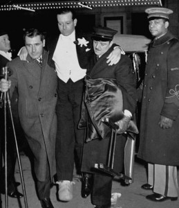 Composer Cole Porter being carried to opening night performance of Noel Coward's Set to Music.  (Photo by Ralph Morse/Pix Inc./The LIFE Images Collection/Getty Images)