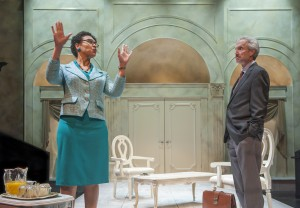 Grace Mugabe (l. Leontyne Mbele-Mbong) describes life with her husband to Dr. Peric (r. Dan Hiatt) in Aurora Theatre Company's West Coast Premiere of Breakfast with Mugabe