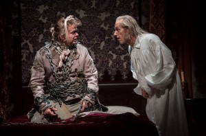 Joe Foust (Marley) and Larry Yando (Ebenezer Scrooge) in Goodman Theatre's A CHRISTMAS CAROL. Photo by Liz Lauren.