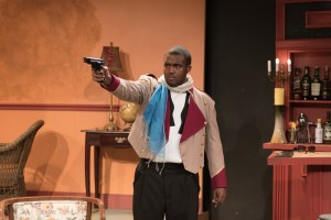 "Joaquim (Anthony Conway) exerts his authority at the Imperial Hotel, in Eclipse Theatre's production of ""Mud, River, Stone"" by Lynn Nottage, directed by Andrea J. Dymond."