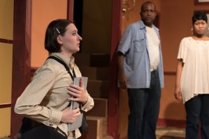 "Simone Frick (Delia Baseman), a humanitarian aid worker, tells David and Sarah Bradley (Robert Hardaway and AnJi White) that help is on the way for a crisis that has spun out of control, in Eclipse Theatre's production of ""Mud, River, Stone"" by Lynn Nottage, directed by Andrea J. Dymond."