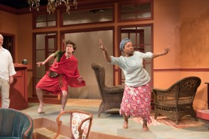 """Neibert (Matt Thinnes) joins Ama (Elana Elyce) in a traditional African dance, in Eclipse Theatre's production of """"Mud, River, Stone"""" by Lynn Nottage, directed by Andrea J. Dymond."""