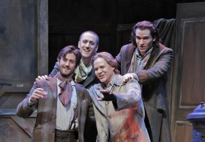 San Francisco Opera's La Boheme. Hadleigh Adams (Schaunard), Christian Van Horn (Colline), Alexey Markov (Marcello) and Michael Fabiano (Rodolfo). Photo by Cory Weaver.