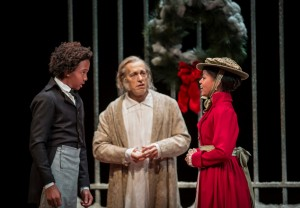 William Burke (Young Scrooge), Larry Yando (Ebenezer Scrooge) and Paige Collins (Fan) in Goodman Theatre's A CHRISTMAS CAROL. Photo by Liz Lauren.
