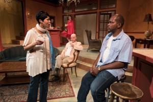 "Sarah and David Bradley (AnJi White and Robert Hardaway, foreground) argue while vacationing in Africa at the Imperial Hotel, as Joaquim (Anthony Conway), Neibert (Matt Thinnes), and Mr. Blake (Zach Bloomfield) look on, in Eclipse Theatre's production of ""Mud, River, Stone"" by Lynn Nottage, directed by Andrea J. Dymond."