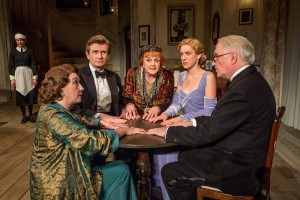 """L-R: Susan Louise O'Connor (standing), Sandra Shipley, Charles Edwards, Angela Lansbury, Charlotte Parry and Simon Jones in the North American tour of Noël Coward's """"Blithe Spirit."""""""