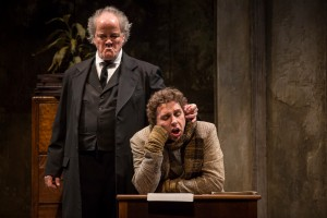 Francis Guinan (Scrooge) and Tim Stoltenberg (Bob Cratchit) in The Second City's Twist Your Dickens, Or Scrooge You! by Peter Gwinn and Bobby Mort at Goodman Theatre.