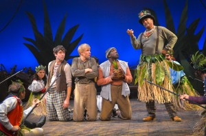 Jeremy Kahn, Tim Homsley, and Cyril Jamal Cooper are cornered while Michael Gene Sullivan as Fighting Prawn explains their predicament in the TheatreWorks production of PETER AND THE STARCATCHER playing December 3, 2014 - January 3, 2015 at the Lucie Stern Theatre in Palo Alto. Photo by Keven Berne.