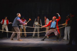 Slank (Will Springhorn Jr.) and Black Stache (Patrick Kelly Jones) duel in the TheatreWorks production of PETER AND THE STARCATCHER playing December 3, 2014 - January 3, 2015 at the Lucie Stern Theatre in Palo Alto. Photo by Keven Berne.