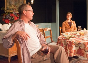 """Richard Apple (David Parkes, left) and Marian Apple Platt (Juliet Hart, right) face off over the """"us"""" vs. """"them"""" nature of American politics in TimeLine Theatre's Chicago premiere of That Hopey Changey Thing, Part 1 of Richard Nelson's The Apple Family Plays, directed by Louis Contey, presented on an alternating schedule with Part 3, Sorry, at 615 W. Wellington Ave., Chicago, January 13 - April 19, 20. Photo by Lara Goetsch."""
