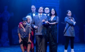 Karl Hamilton and Rebecca Prescott (center) play Gomez and Morticia, with (from left) Brennan Dougherty, Amanda Hartley, Jeff Diebold, Harter Clingman and Dara Cameron