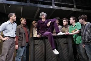 Caron Buinis (center) with (back, left to right), Eric Lindahl, Scott Danielson, Randy Johnson, George Toles, Garrett Lutz, Greg Foster and Seth Steinberg in Kokandy's Productions' THE FULL MONTY with music and lyrics by David Yazbek, book by Terrence McNally, directed by John D. Glover, choreography by Danny Spagnuolo and music direction by Kory Danielson. Credit: Joshua Albanese Photography.
