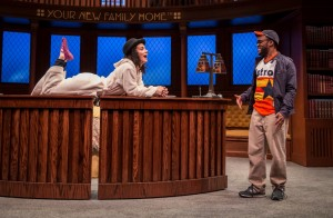Alejandra Escalante (Rebecca Oaxaca) and Travis Turner (Astros Guy) in The Upstairs Concierge by Kristoffer Diaz, directed by KJ Sanchez at Goodman Theatre.