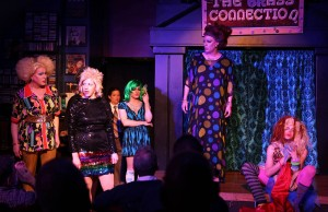 """Annie's Teaching Methods"" (left to right) Gloria Blaze (Ed Jones), Annie Sullivan (Elizabeth Lesinski), Janet (Laura Coleman) and Bailey Legal (Kristopher Bottrall) look on as Helen Stellar (Steve Love) struggles to adjust to her new teacher in Hell in a Handbag Productions' Midwest premiere of MIRACLE!, a drag parody of The Miracle Worker by Dan Savage, directed by Derek Van Barham. Photo by Rick Aguilar Studios."