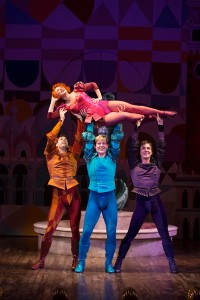 Megan Sikora as Bianca, Barrett Martin as Gremio, Giovanni Bonaventura as Hortensio, and Tyler Hanes as Lucentio in the Hartford Stage-Old Globe co-production of KISS ME, KATE.