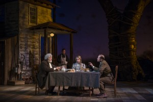 Francis Guinan (Samuel Hamilton), Stephen Park (Lee), and ensemble members Kate Arrington (Cathy Trask) and Tim Hopper (Adam Trask) have dinner together in Steppenwolf Theatre Company's production of John Steinbeck's East of Eden, a world premiere adapted by ensemble member Frank Galati and directed by co-founder Terry Kinney.