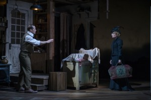 Tim Hopper (Adam Trask) and Kate Arrington (Cathy Trask) argue after the birth of the twins in Steppenwolf Theatre Company's production of John Steinbeck's East of Eden, a world premiere adapted by ensemble member Frank Galati and directed by co-founder Terry Kinney.