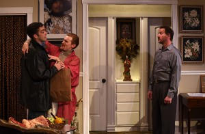 Mike (Joel Reitsma) delivers a record to Mendy (JP Pierson) and Stephen (Joe McCauley) in Eclipse Theatre's THE LISBON TRAVIATA. Photo by Scott Dray.