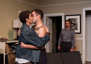 Paul (Luke Daigle) and Mike (Joel Reitsma) share an intimate moment as Stephen (Joe McCauley) teems with anger in Eclipse Theatre's THE LISBON TRAVIATA. Photo by Scott Dray.