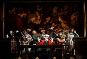 The cast with John Rapson as Lord Adalbert D'Ysquith (red) in A GENTLEMAN'S GUIDE TO LOVE AND MURDER National Tour. Photo by Joan Marcus.