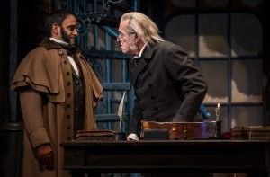 Anish Jethmalani (Fred) and Larry Yando (Ebenezer Scrooge) in A Christmas Carol at Goodman Theatre (November 14 – December 27, 2015).