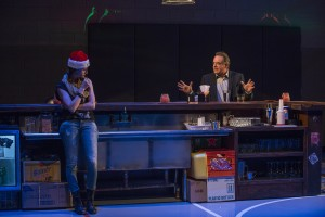 Rae Gray (Bartender) and Tom Irwin (Bill) in Steppenwolf Theatre Company's production of Domesticated, written and directed by Bruce Norris.