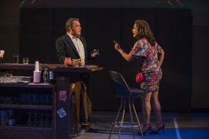 Tom Irwin (Bill) and Esteban Andres Cruz (Woman in Bar) in Steppenwolf Theatre Company's production of Domesticated, written and directed by ensemble member Bruce Norris.