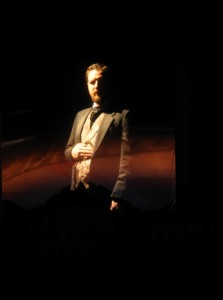Drew Johnson, vanishing before your eyes in a two-way-mirror stage effect, in City Lit's THE GILDED AGE-A TALE OF TODAY.