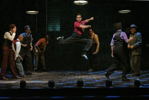 Jonathan Luke Stevens (center) and cast in The Oregon Shakespeare Festival Production of GUYS & DOLLS. Photo by Kevin Parry.