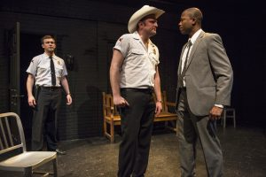 Drew Schad, Joseph Wiens and Manny Buckley in Shattered Globe Theatre's production of IN THE HEAT OF THE NIGHT, adapted by Matt Pelfrey, based on the novel by John Ball and directed by Louis Contey. Photo by Michael Brosilow.