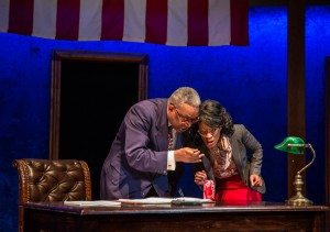 Tim Edward Rhoze (Carlyle's Father) and Charlette Speigner (Ensemble) in Carlyle by Thomas Bradshaw, directed by Benjamin Kamine at Goodman Theatre.