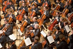 Over 100 cellists on stage at Walt Disney Concert Hall under conductor Matthew Aucoin. (Photo by Dario Griffin-USC)