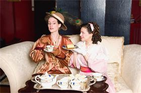 Maeghan Looney as Gwendolen Fairfax and Megan DeLay as Cecily Cardew.