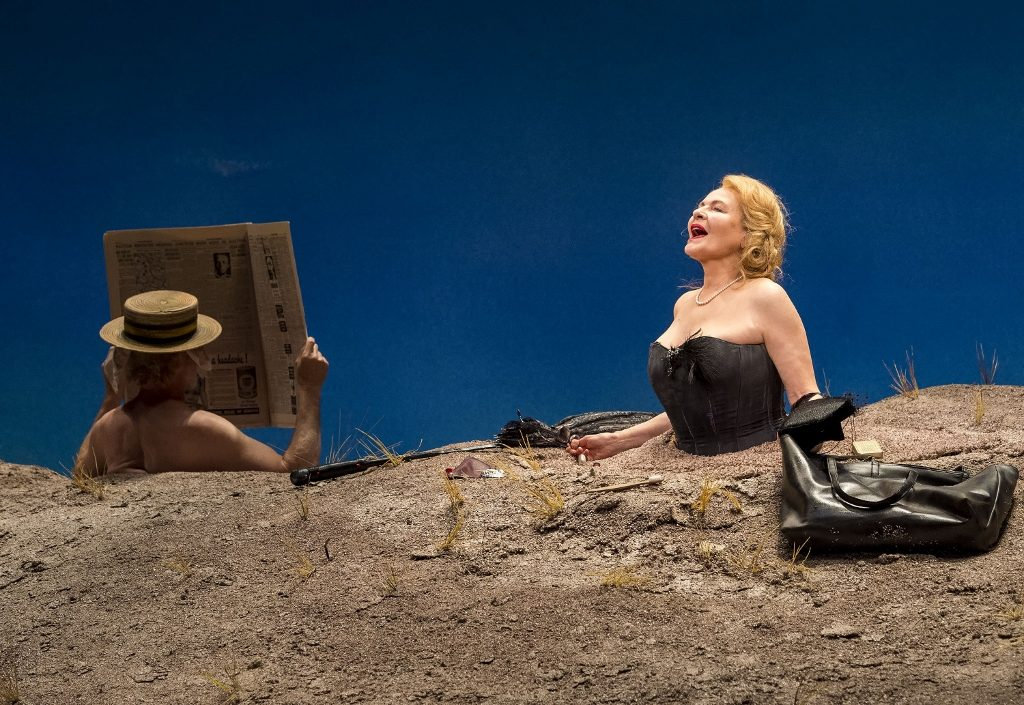 "L-R: Michael Rudko (obscured) and Dianne Wiest in the Yale Repertory Theatre production of Samuel Beckett's ""Happy Days"" at the Mark Taper Forum. Directed by James Bundy, ""Happy Days"" will play at the Taper through June 30, 2019."