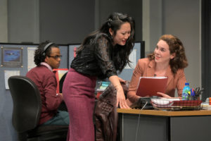 Kendra (Melanie Arii Mah) and Ani (Martha Brigham) sneak a peek at Dean's manuscript while the intern, Miles (Jared Corbin), watches in Branden Jacobs-Jenkins's Gloria, performing at A.C.T.'s Strand Theater now through Sunday, April 12, 2020. Photo: Kevin Berne