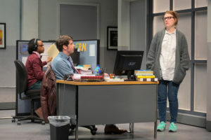 Gloria (Lauren English, right) stops by the desk of Dean (Jeremy Kahn) while the intern, Miles (Jared Corbin), watches in Branden Jacobs-Jenkins's Gloria, performing at A.C.T.'s Strand Theater now through Sunday, April 12, 2020. Photo: Kevin Berne