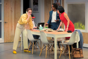 Callie (Martha Brigham) receives the call that a client has arrived at the office while Rashaad (Jared Corbin) and Jenna (Melanie Arii Mah) listen in Branden Jacobs-Jenkins's Gloria, performing at A.C.T.'s Strand Theater now through Sunday, April 12, 2020. Photo: Kevin Berne